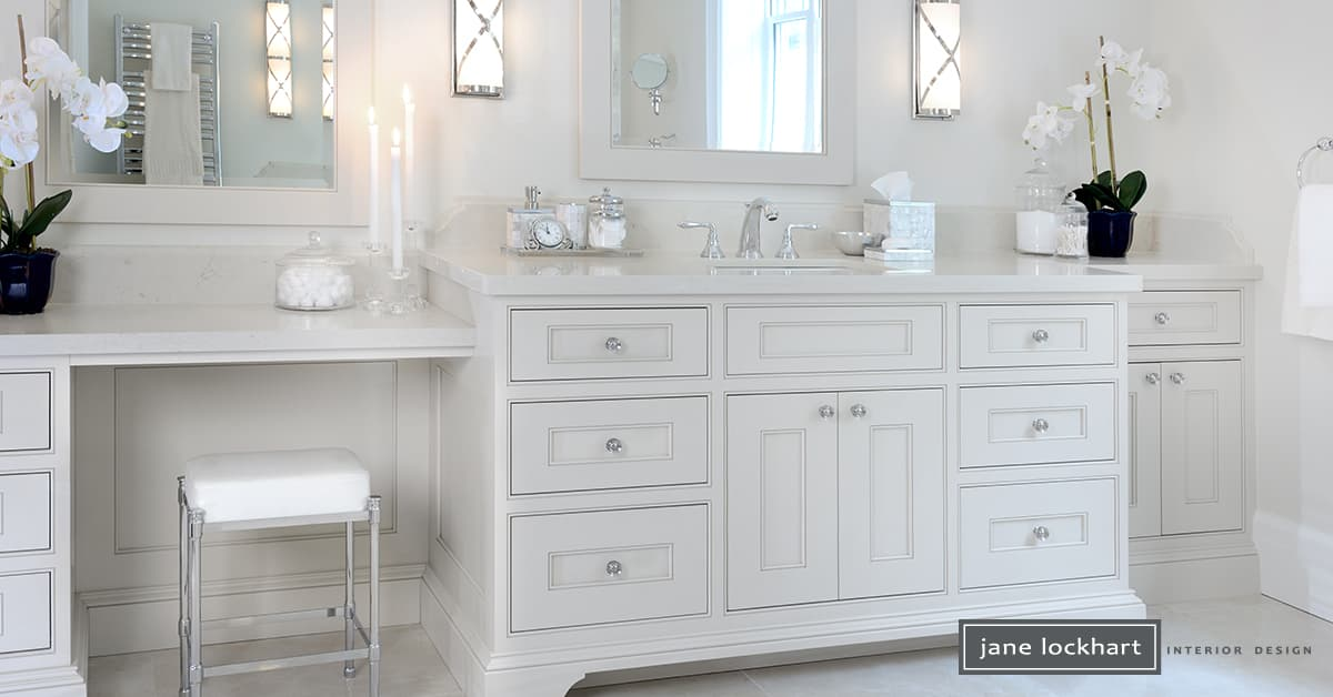 white painted bathroom walls, cabinetry and sink