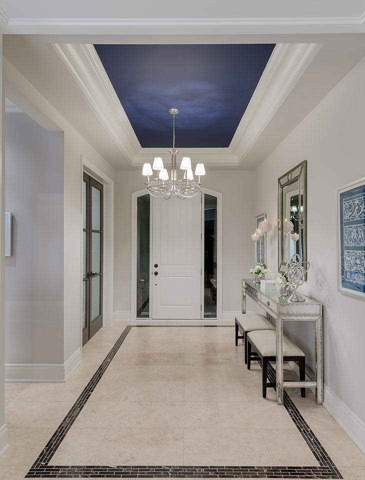 bright hallway leading to front door