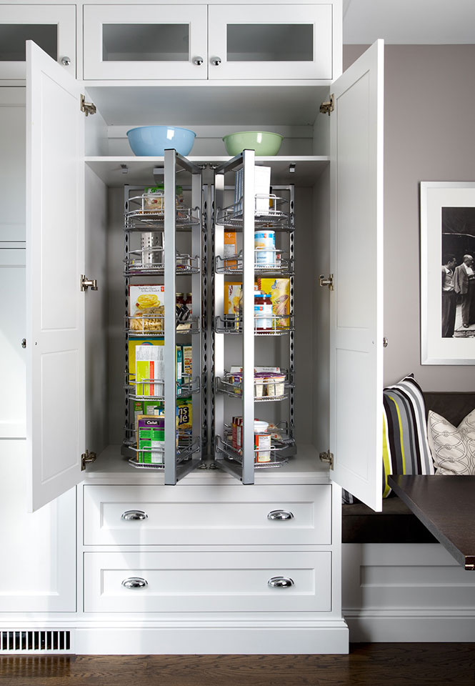 White kitchen pantry with doors open.
