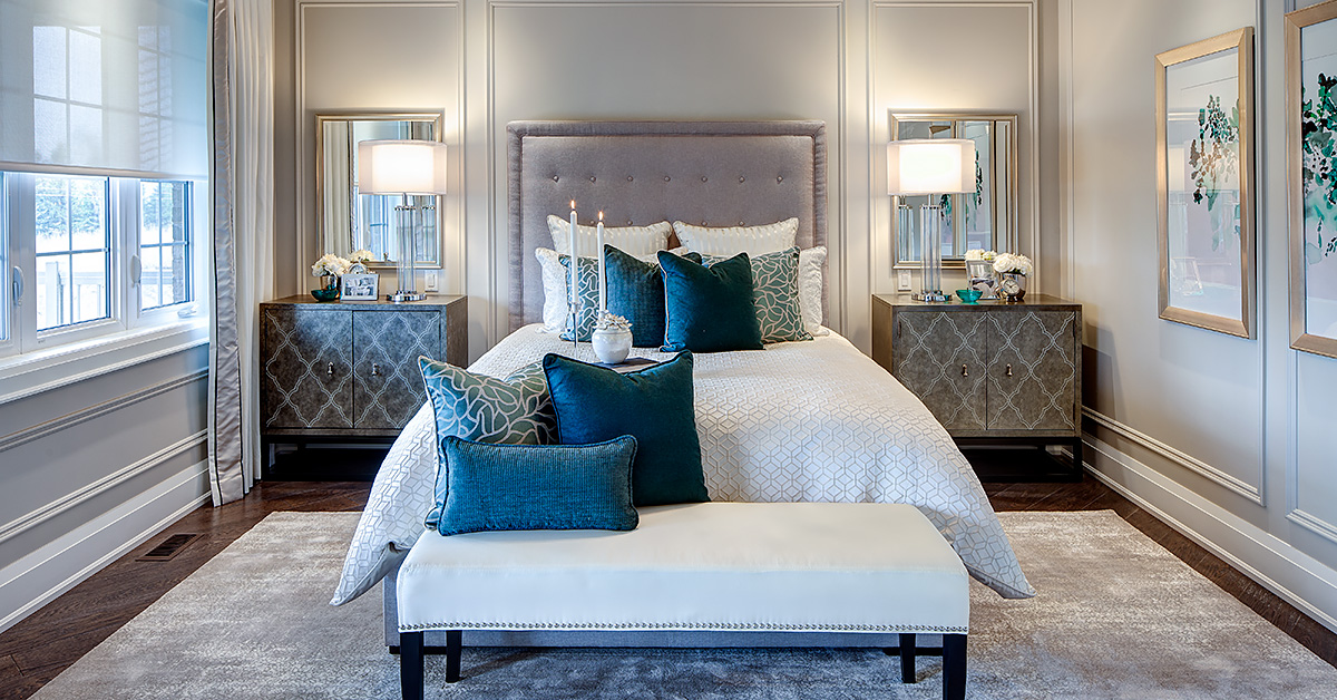 spacious bedroom with white bed and blue pillows
