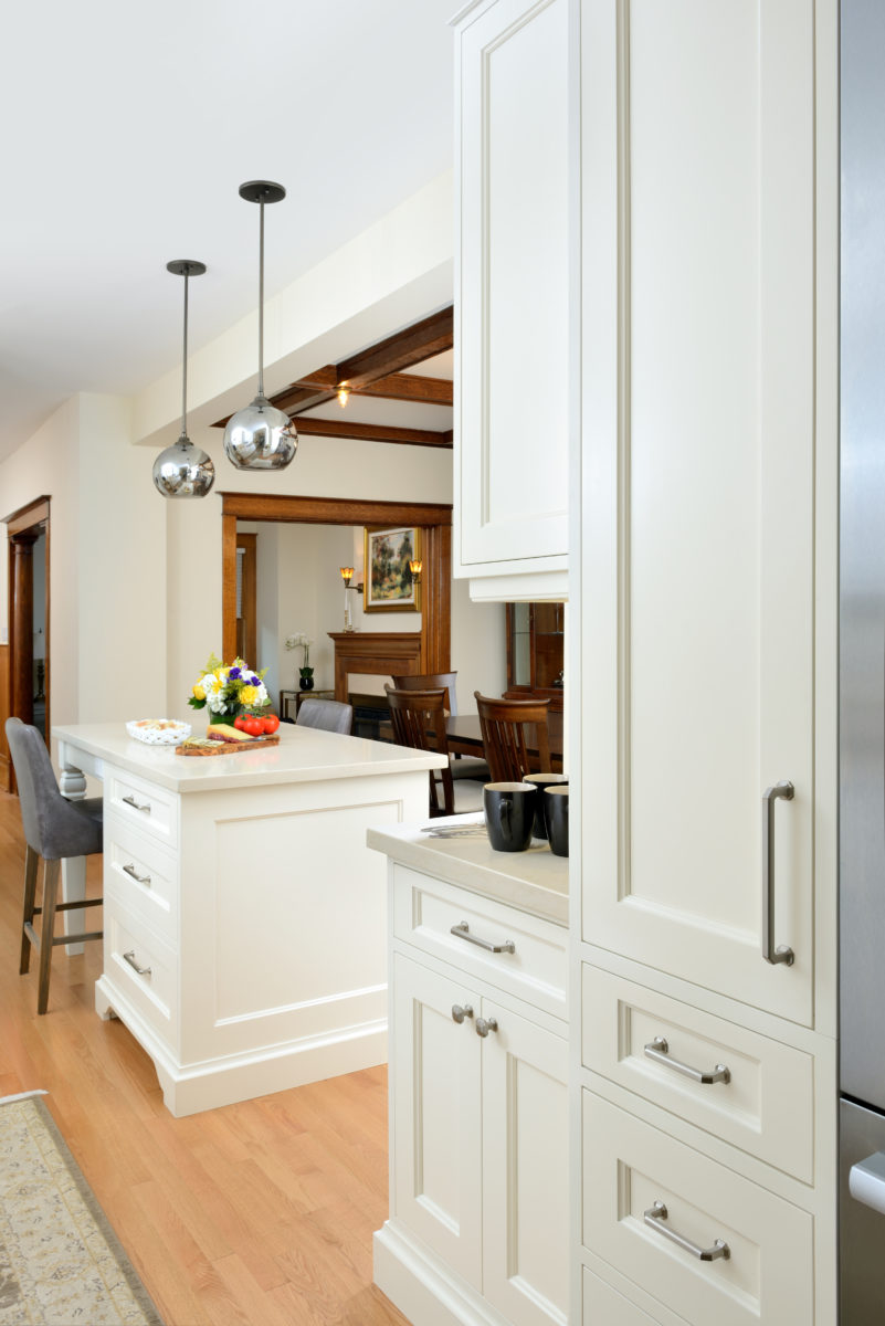 Open Concept kitchen with view of original wood trim.