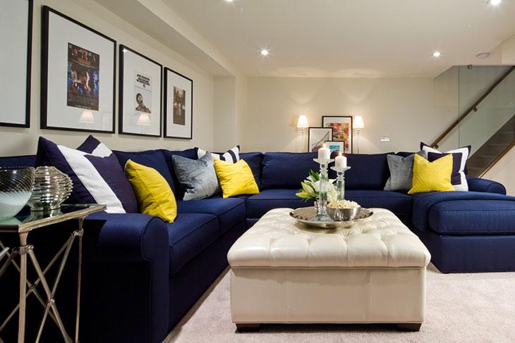 blue sofa cream ottoman in basement