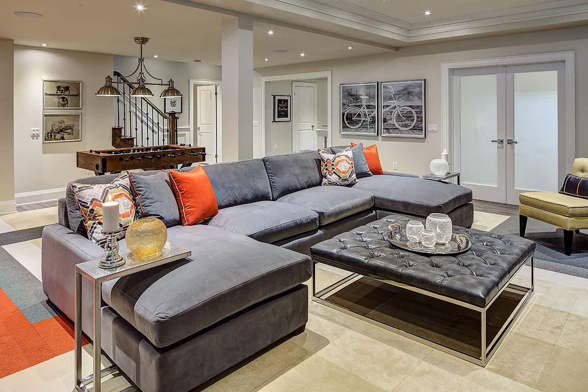 gray sofa in basement family room
