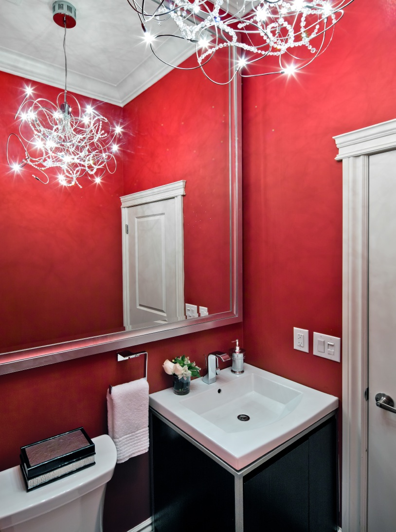 Bold red walls in powder room