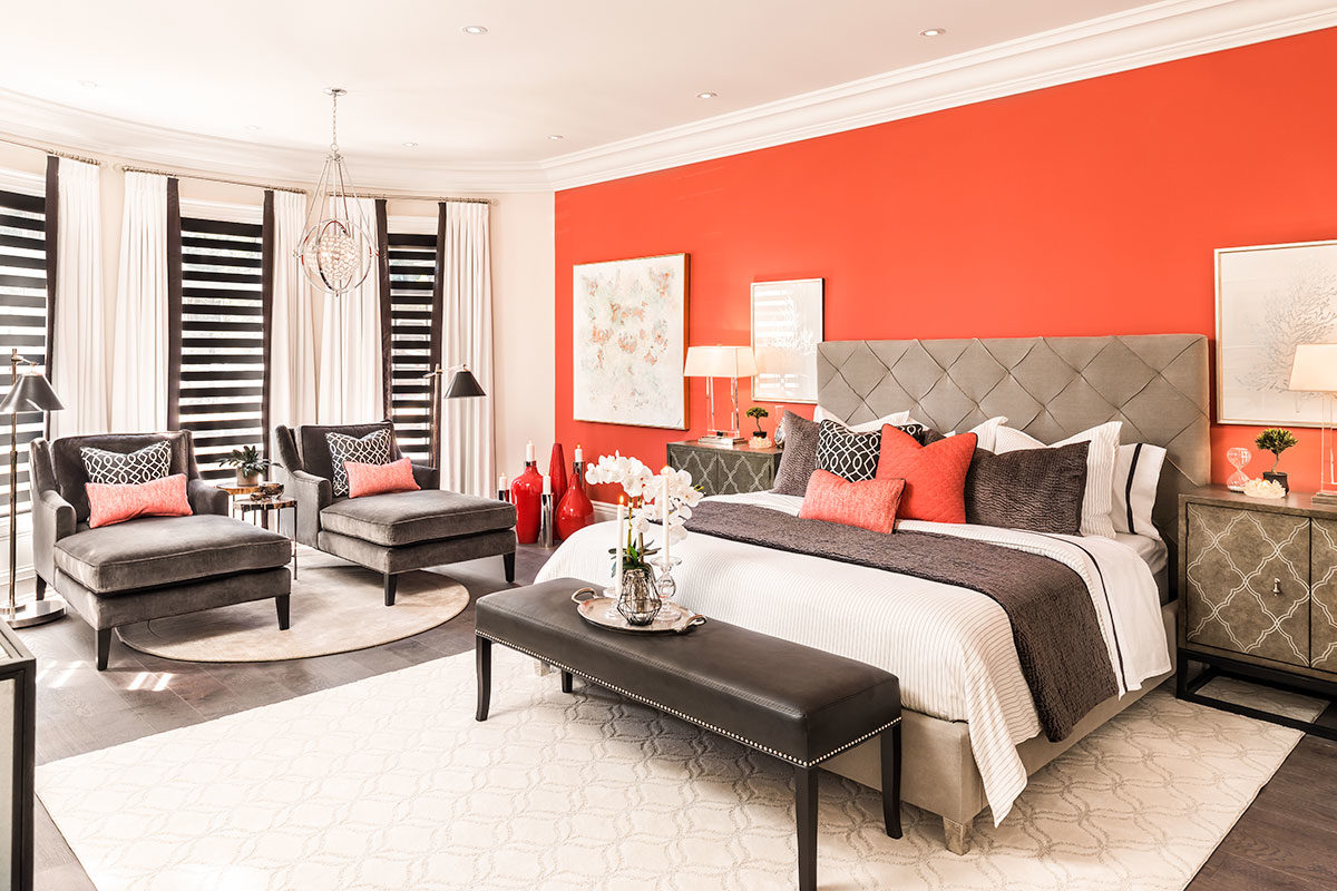 Bright orange accent wall in bedroom