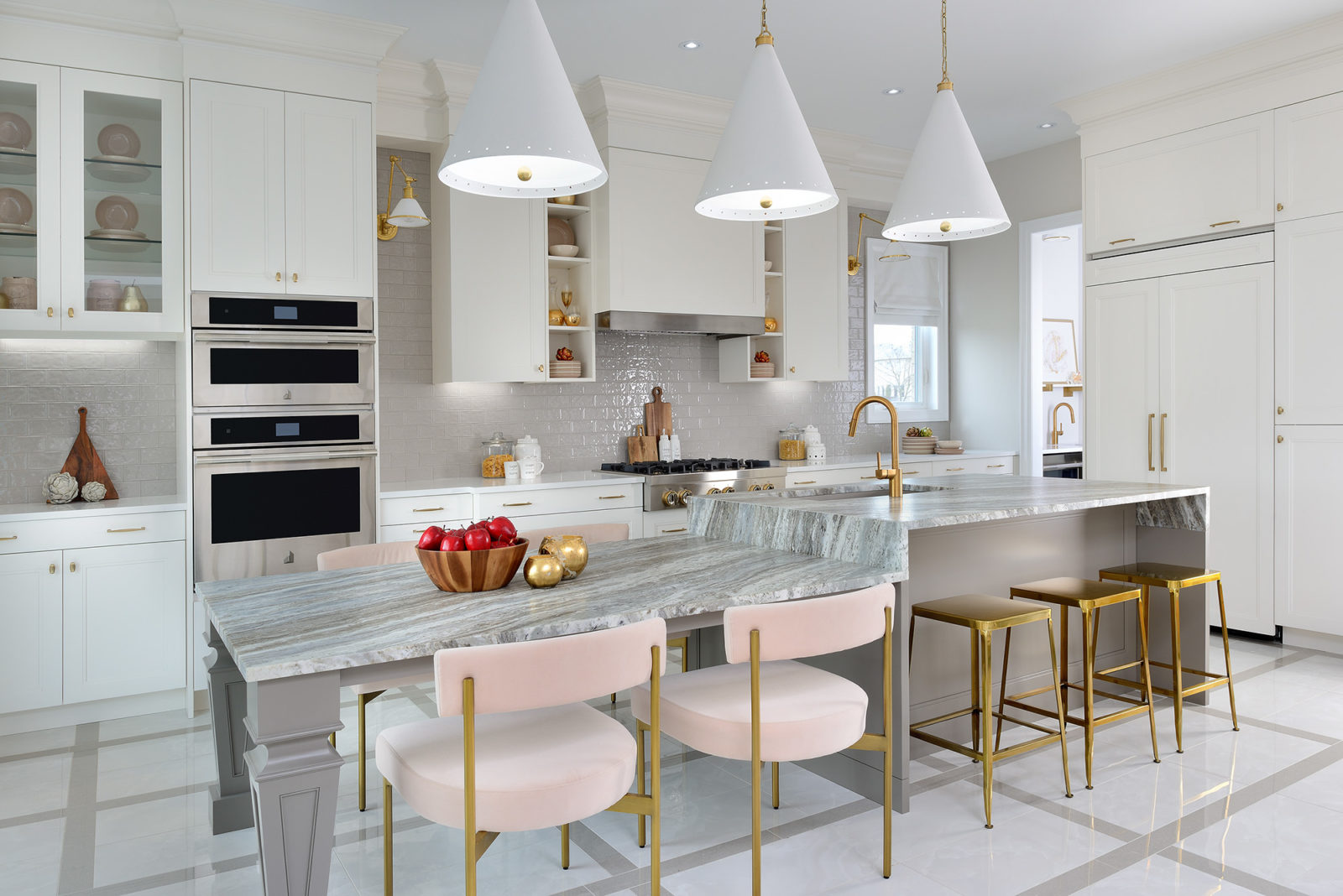 Gold lighting and fixtures in kitchen
