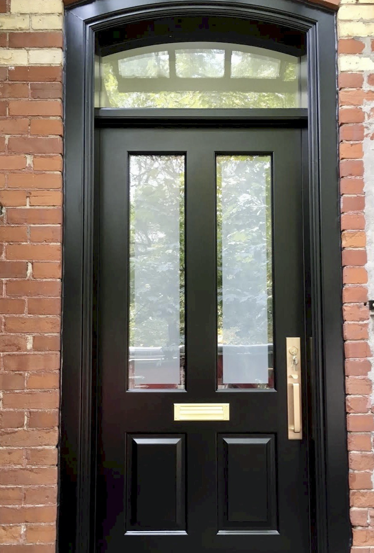 """Blackened"" green front door"