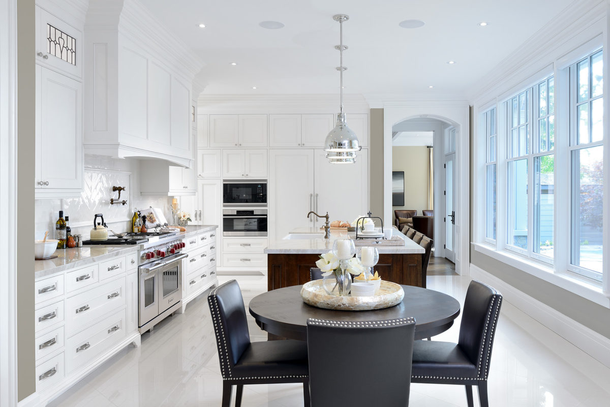 Long kitchen island and cabinetry with separate table