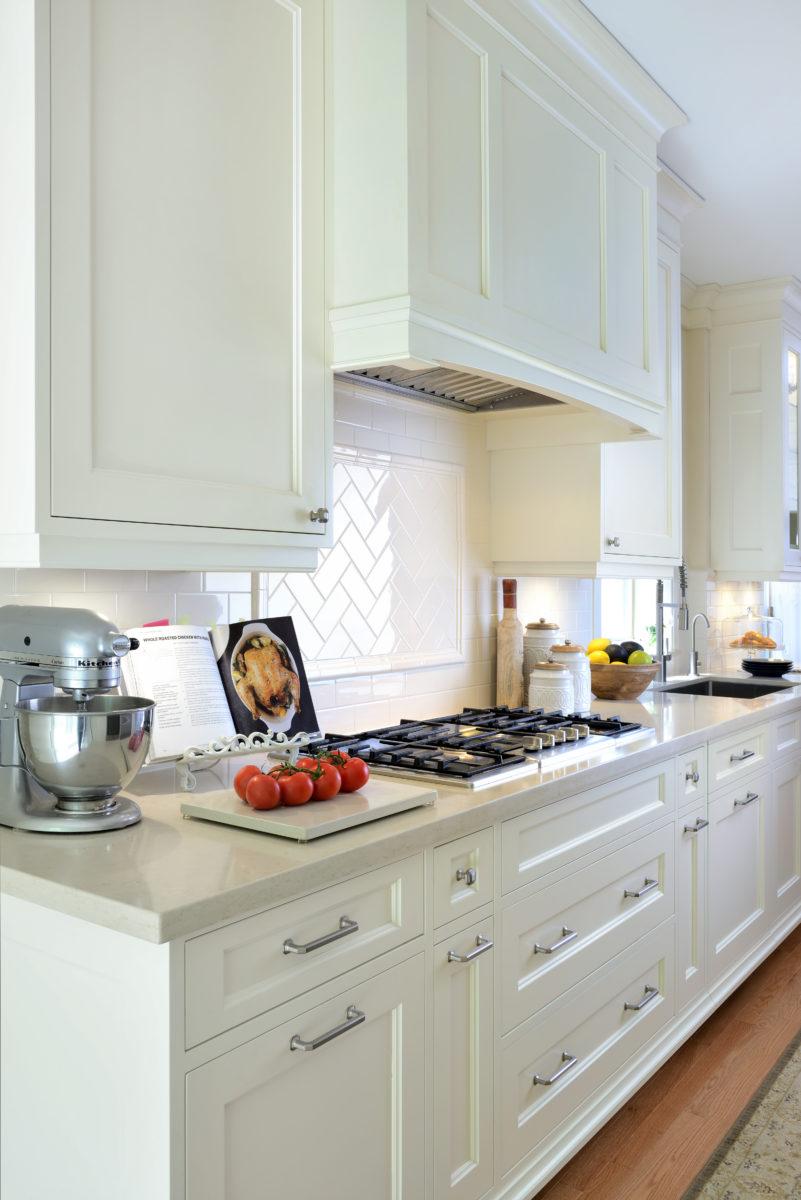 Five burner cook top in renovated kitchen
