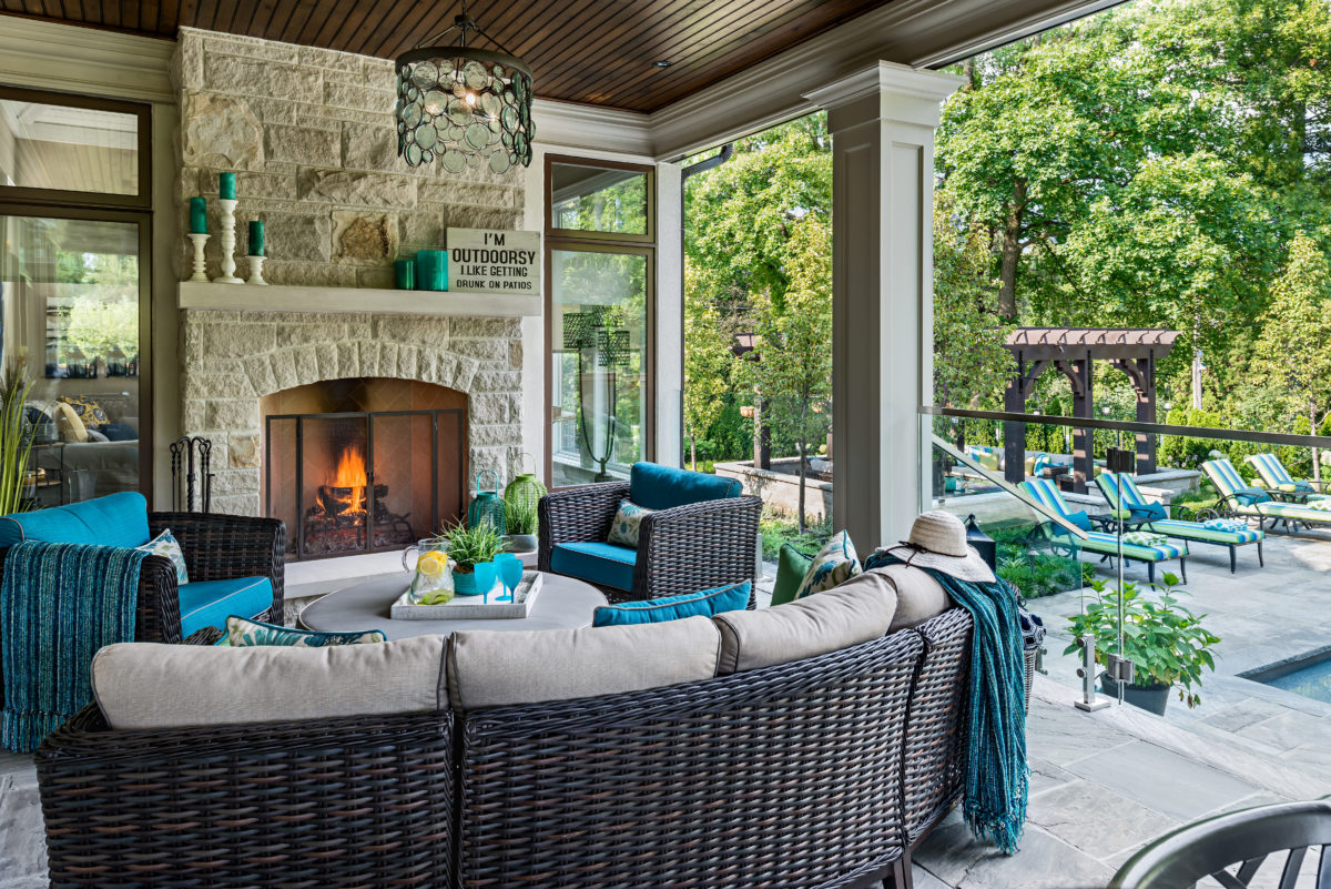 patio furniture by the outdoor fireplace