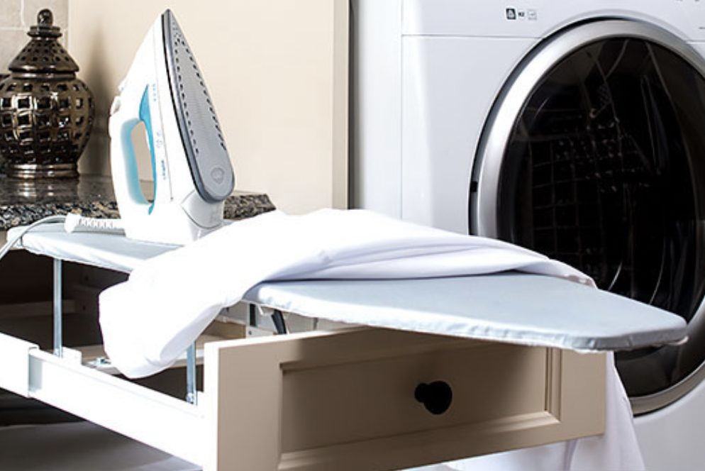 The hottest laundry room design trends Ironing board in a drawer
