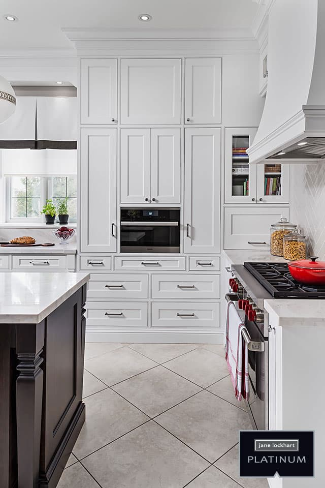 White kitchen cabinetry with built in microwave and gas stove jane lockhart interior design