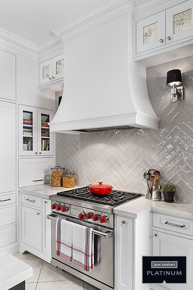 Wolf stove with white range hood and tile backsplash jane lockhart interior design