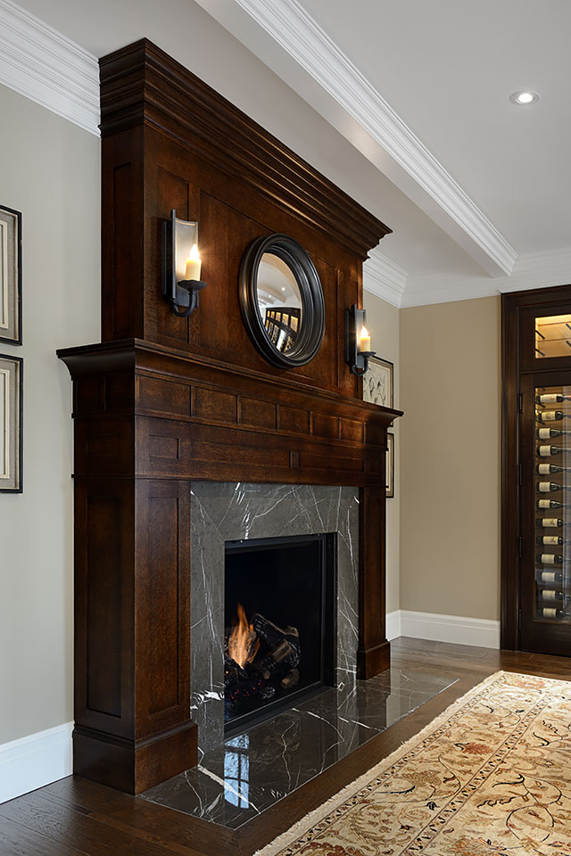 The traditional fireplace mantel adds a timeless elegance to a room.