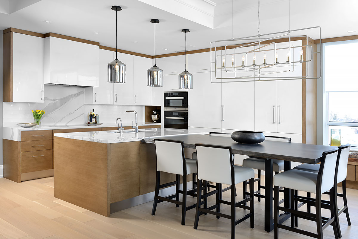 One of the first things you see when you enter the spacious open concept room is the kitchen modern cabinetry in white marries well with the solid maple