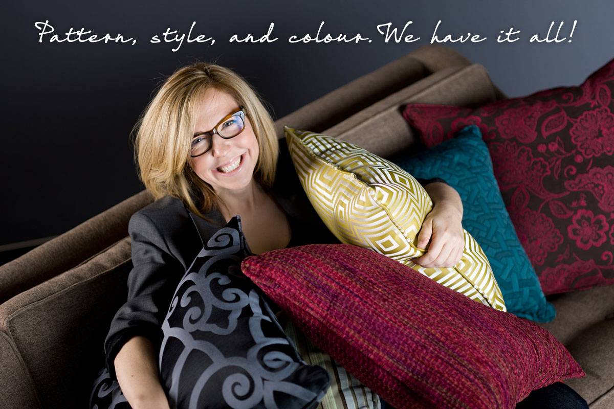 Jane Lockhart on a brown sofa with colourful pillows.
